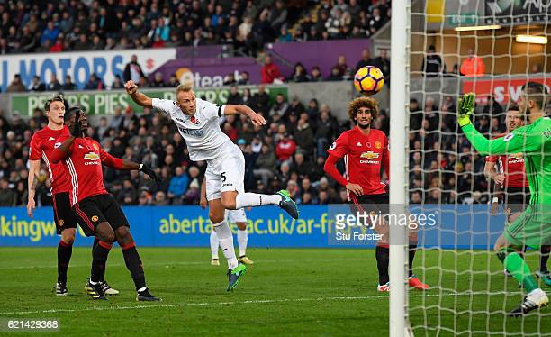 Mike van der Hoorn of Swansea City scores his sides first goal during the Premier League match between Swansea City and Manchester United at Liberty...