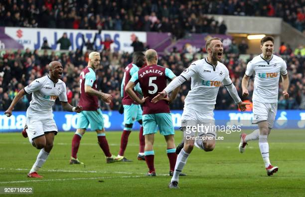 Mike van der Hoorn of Swansea City scores his sides second goal during the Premier League match between Swansea City and West Ham United at Liberty...