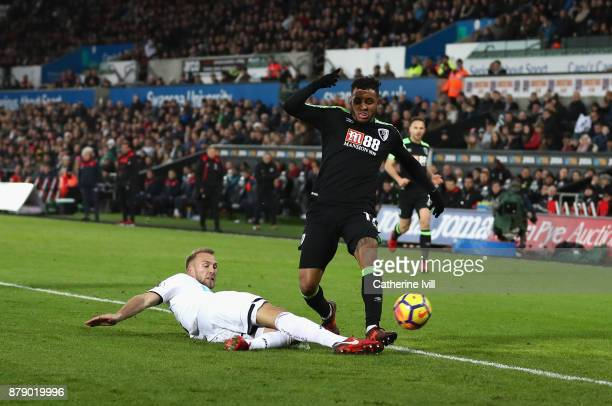 Mike van der Hoorn of Swansea City tackles Joshua King of AFC Bournemouth during the Premier League match between Swansea City and AFC Bournemouth at...