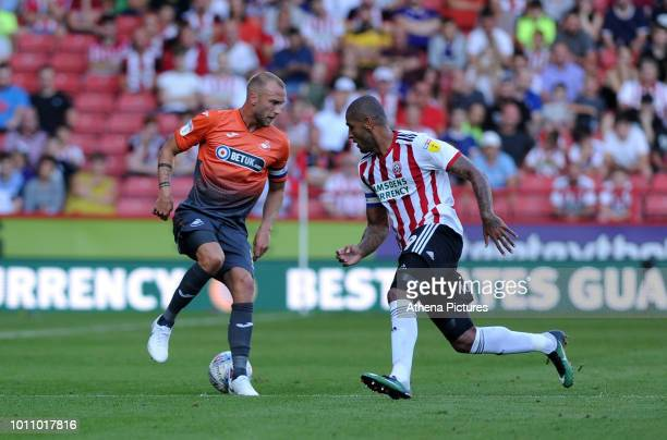 Mike van der Hoorn of Swansea City vies for possession with Leon Clarke of Sheffield United during the Sky Bet Championship match between Sheffield...