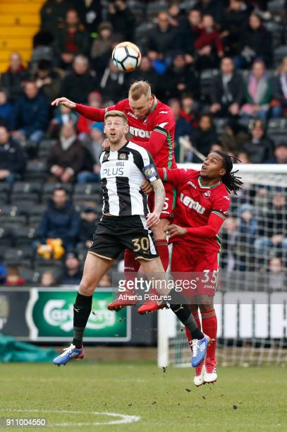 Mike van der Hoorn of Swansea City wins the ball in the air from Jonathan Stead of Notts County supported by teammate Renato Sanches of Swansea City...