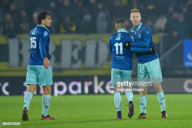 Mike van Duinen of Excelsior celebrates 21 with Jurgen Mattheij of Excelsior Stanley Elbers of Excelsior during the Dutch Eredivisie match between...