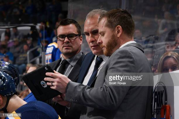 Mike Van Ryn Craig Berube and Steve Ott of the St. Louis Blues look at a replay during a timeout in the game against the Winnipeg Jets at Enterprise...