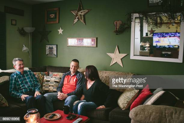 Mike Vaughn at center watches a Wisconsin Badgers basketball game with his father Dave Vaughn and his wife Barb Vaughn After the Janesville GM...