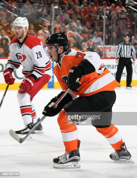 Mike Vecchione of the Philadelphia Flyers in action against Bryan Bickell of the Carolina Hurricanes on April 9 2017 at the Wells Fargo Center in...