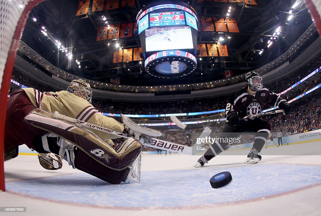 Mike Vecchione #21 of the Union College Dutchmen scores a goal past Thatcher Demko #30 of the Boston College Eagles during the 2014 NCAA Division I Men's Hockey Championship Semifinal at Wells Fargo Center on April 10, 2014 in Philadelphia, Pennsylvania.