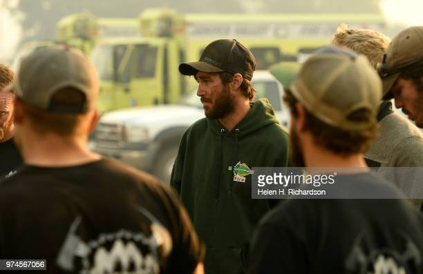 Mike Von Lintig a firefighter with a Type II hand crew with Idaho Department of Lands gets the daily briefing with his crew before heading out for...