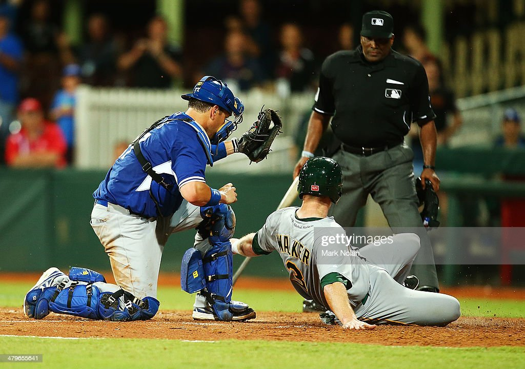 Mike Walker of Australia is tagged out on home base by A.J. Ellis of the Dodgers during the match between Team Australia and the LA Dodgers at Sydney Cricket Ground on March 20, 2014 in Sydney, Australia.