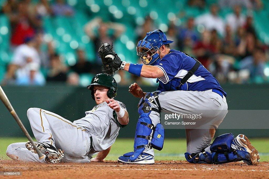 Mike Walker of Australia is tagged out on home plate by A.J. Ellis of the Dodgers during the match between Team Australia and the LA Dodgers at Sydney Cricket Ground on March 20, 2014 in Sydney, Australia.