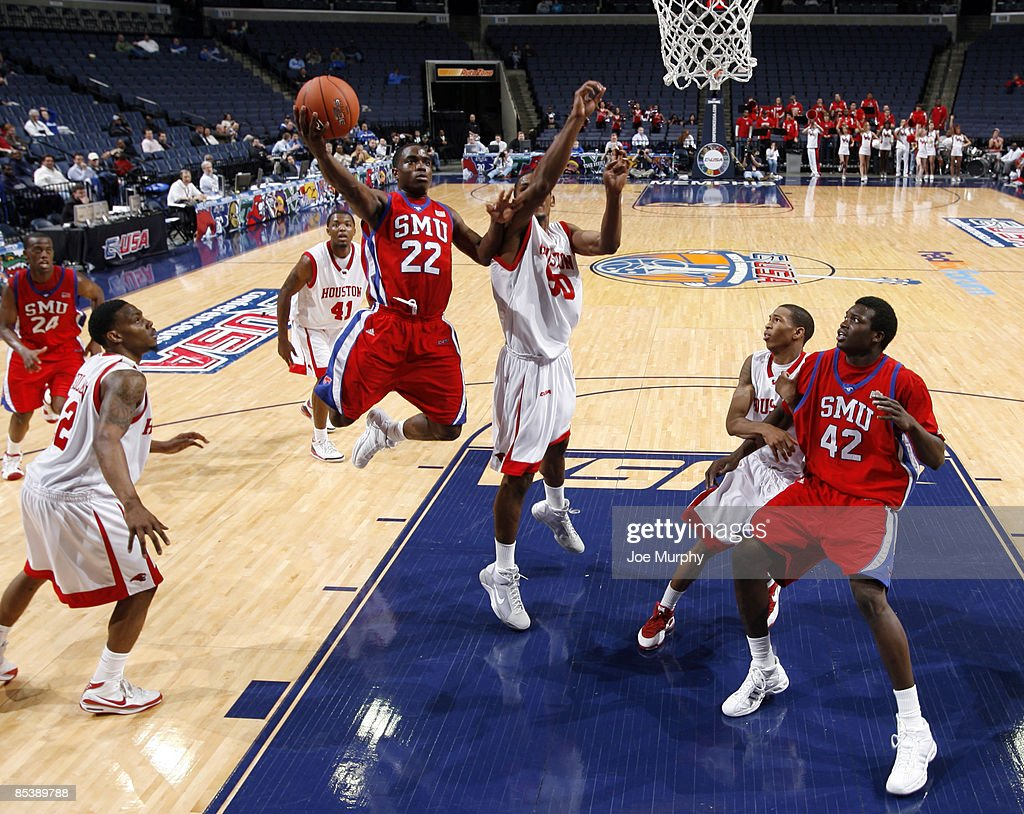 Mike Walker #22 of the SMU Mustangs shoots a layup past Marcus Cousin #50 of the Houston Cougars during Round One of the Conference USA Basketball Tournament at FedExForum on March 11, 2009 in Memphis, Tennessee. Houston beat SMU