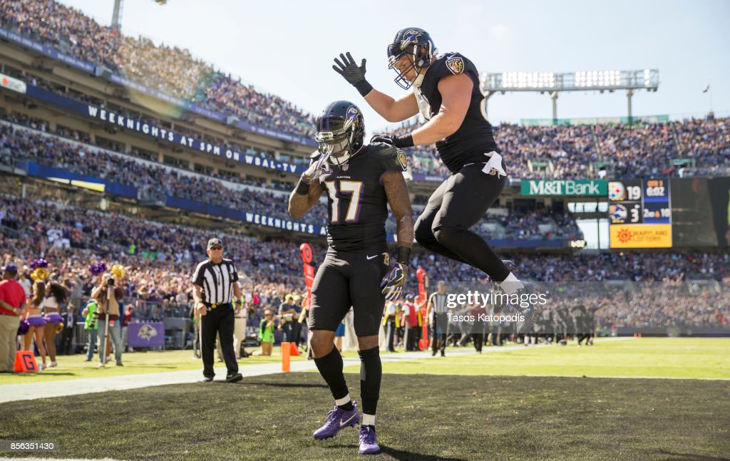Mike Wallace #17 of the Baltimore Ravens and Nick Boyle #86 of the Baltimore Ravens celebrate a touchdown against the Pittsburgh Steelers in the third quarter at M&T Bank Stadium on October 1, 2017 in Baltimore, Maryland.