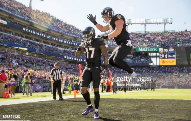 Mike Wallace of the Baltimore Ravens and Nick Boyle of the Baltimore Ravens celebrate a touchdown against the Pittsburgh Steelers in the third...