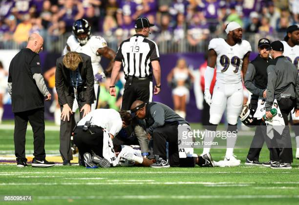 Mike Wallace of the Baltimore Ravens lies on the field while being assessed by medical staff in the first quarter of the game against the Minnesota...
