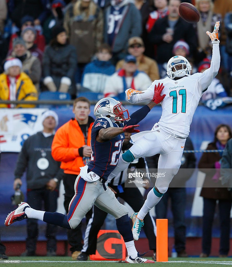 Mike Wallace #11 of the Miami Dolphins catches a touchdown pass as Malcolm Butler #21 of the New England Patriots defends during the second quarter at Gillette Stadium on December 14, 2014 in Foxboro, Massachusetts.