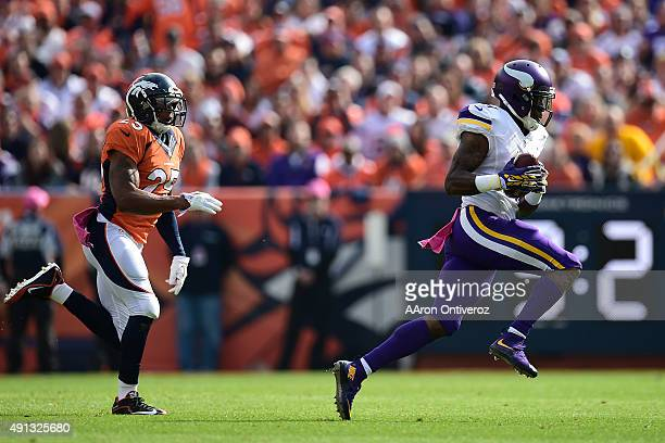 Mike Wallace of the Minnesota Vikings outruns Chris Harris of the Denver Broncos on a first down catch in the first quarter The Denver Broncos played...