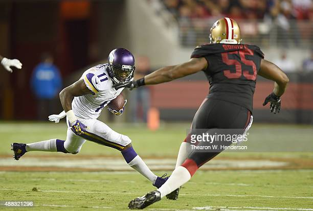 Mike Wallace of the Minnesota Vikings runs with the ball while pursued Ahmad Brooks of the San Francisco 49ers during their NFL game at Levi's...
