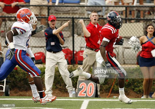 Mike Wallace of the Mississippi Rebels runs for a touchdown against Major Wright of the Florida Gators on September 22 2007 at VaughtHemingway...