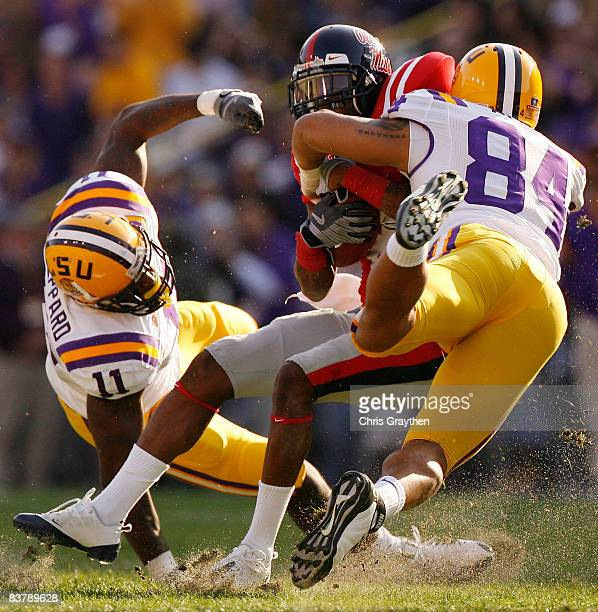 Mike Wallace of the Ole Miss Rebels is tackled by Rahim Alem of the Louisiana State University Tigers on November 22, 2008 at Tiger Stadium in Baton...