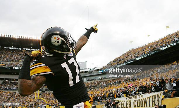 Mike Wallace of the Pittsburgh Steelers celebrates following his touchdown against the Cincinnati Bengals in the first half during the game on...