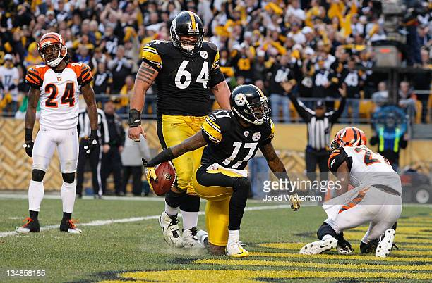 Mike Wallace of the Pittsburgh Steelers celebrates in front of teammate Doug Legursky after scoring a touchdown against the Cincinnati Bengals in the...