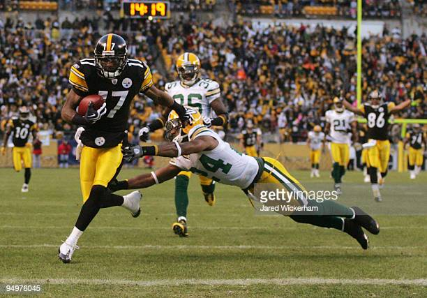 Mike Wallace of the Pittsburgh Steelers runs for a touchdown as Jarrett Bush of the Green Bay Packers attempts to tackle in the first quarter during...