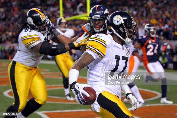 Mike Wallace of the Pittsburgh Steelers runs the ball for a touchdown in the third quarter against the Denver Broncos during the AFC Wild Card...