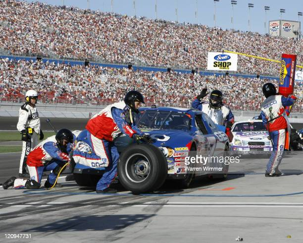 Mike Wallace sits in his race car while his Pit Crew does fuel and tires at the Crown Jewel of race tracks the Las Vegas Motor Speedway Las Vegas...