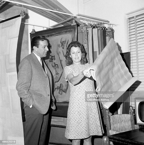 Mike Wallace with his third wife Lorraine Perigord at an art gallery Image dated February 28 1967 New York NY