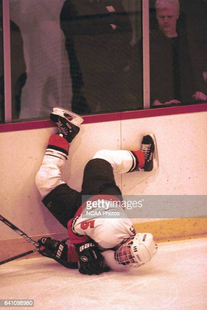 Mike Walling of Rochester Institute of Technology gets up ended along the boards during the 2001 NCAA Men's Ice Hockey Championship held at Ritter...