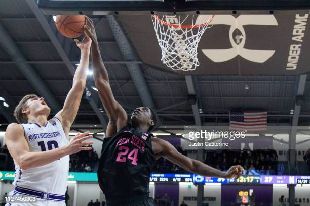 Mike Watkins of the Penn State Nittany Lions blocks the shot of Miller Kopp of the Northwestern Wildcats during the second half at WelshRyan Arena on...