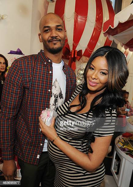 Mike Wayans and Vanessa Simmons attend Vanessa Simmons Baby Shower at Sugar Factory Hollywood on January 18 2014 in Los Angeles California