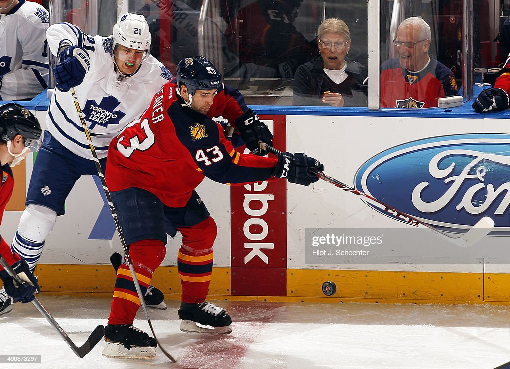 Mike Weaver #43 of the Florida Panthers tangles with James van Riemsdyk #21 of the Toronto Maple Leafs at the BB&T Center on February 4, 2014 in Sunrise, Florida.