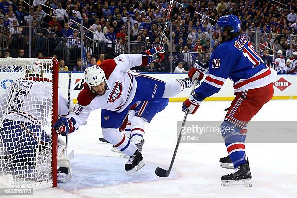 Mike Weaver of the Montreal Canadiens falls to the ice after coming in contact with JT Miller of the New York Rangers in the first period during Game...