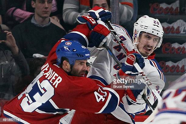 Mike Weaver of the Montreal Canadiens moves Chris Kreider of the New York Rangers from the crease in Game One of the Eastern Conference Final during...