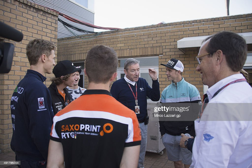 Mike Webb of Great Britain speaks with Moto3 riders after the security briefing during the MotoGP Of Japan - Previews at Twin Ring Motegi on October 8, 2015 in Motegi, Japan.