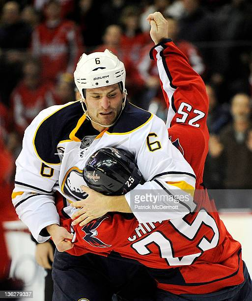 Mike Weber of the Buffalo Sabres and Jason Chimera of the Washington Capitals fight during the first period at Verizon Center on December 30 2011 in...