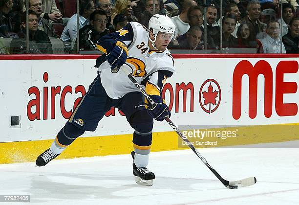 Mike Weber of the Buffalo Sabres passes the puck against the Montreal Canadiens during their NHL game at the Bell Centre November 5 2007 in Montreal...
