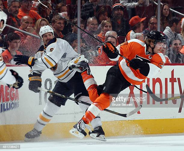 Mike Weber of the Buffalo Sabres takes a third period tripping penalty against Claude Giroux of the Philadelphia Flyers at the Wells Fargo Center on...