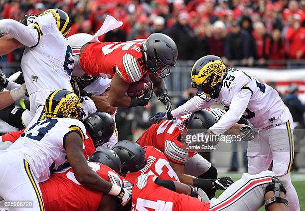 Mike Weber of the Ohio State Buckeyes dives into the end zone for a touchdown during the second half against the Michigan Wolverines at Ohio Stadium...