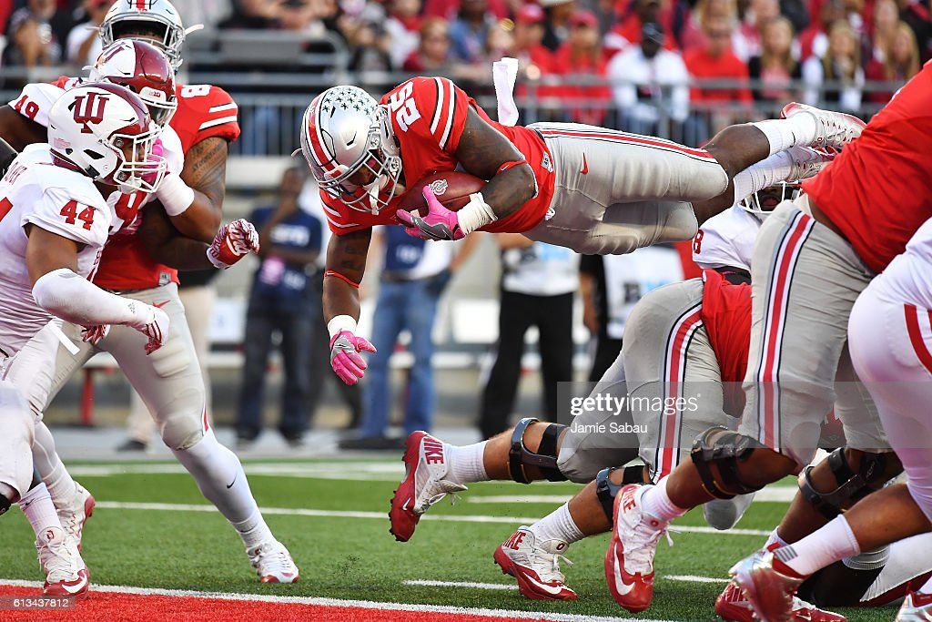 Mike Weber #25 of the Ohio State Buckeyes leaps over the goal line for a one-yard touchdown run in the third quarter against the Indiana Hoosiers at Ohio Stadium on October 8, 2016 in Columbus, Ohio. Ohio State defeated Indiana 38-17.