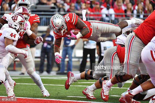 Mike Weber of the Ohio State Buckeyes leaps over the goal line for a oneyard touchdown run in the third quarter against the Indiana Hoosiers at Ohio...