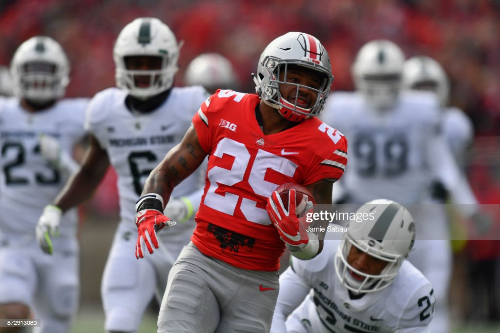 Mike Weber #25 of the Ohio State Buckeyes leaves the Michigan State defense behind as he completes a 47-yard touchdown run in the first quarter at Ohio Stadium on November 11, 2017 in Columbus, Ohio.