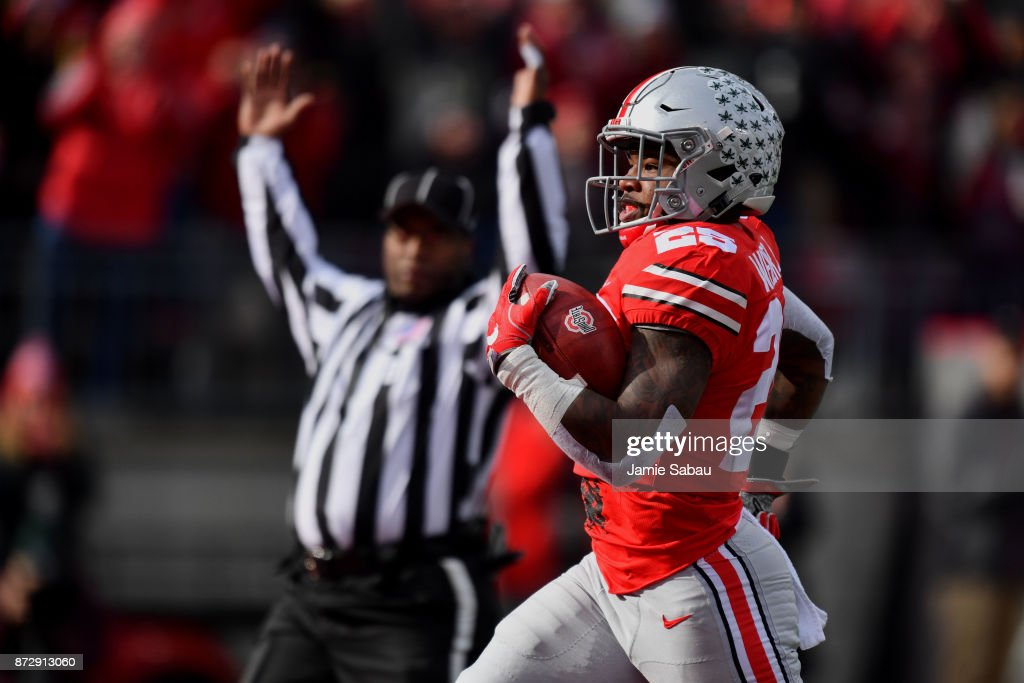 Mike Weber #25 of the Ohio State Buckeyes scores on an 82-yard touchdown run in the second quarter against the Michigan State Spartans at Ohio Stadium on November 11, 2017 in Columbus, Ohio.