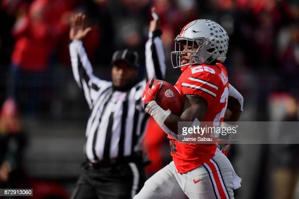 Mike Weber of the Ohio State Buckeyes scores on an 82yard touchdown run in the second quarter against the Michigan State Spartans at Ohio Stadium on...