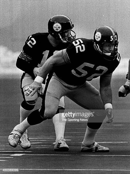 Mike Webster of Pittsburgh Steelers blocs for Terry Bradshaw during a game circa 1979 at Three Rivers Stadium in Pittsburgh Pennsylvania Webster...