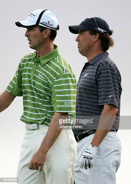 Mike Weir and Stephen Ames wait to tee off on the 13th hole during the third round of the MercedesBenz Championship at the Plantation Course on...