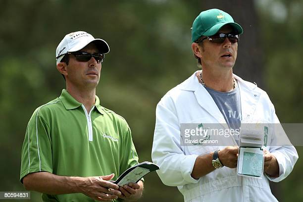 Mike Weir of Canada chats with his caddie Brennan Little on the fourth hole during the first round of the 2008 Masters Tournament at Augusta National...