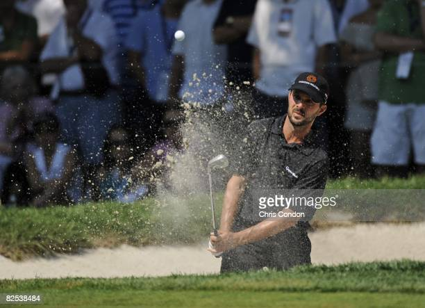 Mike Weir of Canada hits from a bunker on during the final round of The Barclays held at the Ridgewood Country Club on August 24 2008 in Paramus New...