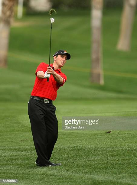 Mike Weir of Canada hits from the fairway on the eighth hole on the Palmer Private Course at PGA West during the first round of the Bob Hope Chrysler...