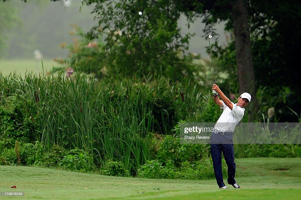 Mike Weir of Canada hits his second shot on the ninth hole during a continuation of the first round of the Sanderson Farms Championship at Annandale Golf Club on July 19, 2013 in Madison, Mississippi.